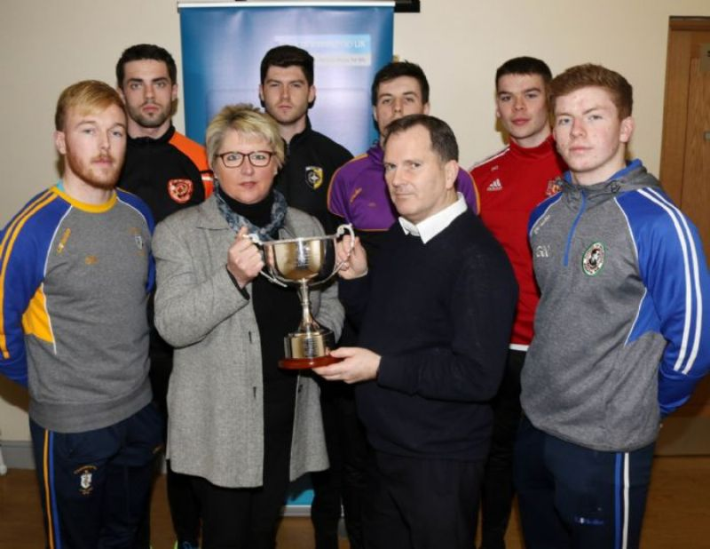 Colm McLarnon, Kickham's Secretary and son of the late Paddy McLarnon and Angela Callan from the tournament sponsors the Bank Of Ireland with captains from six of the club's taking part. Included are Deaglan Murphy (Rossa), Brendan Laverty (Lavey), Aidan Rushe (Crossmaglen), James Guinness (Carryduff), Stephen Cunningham (Donaghmoyne) and Daniel Kerr (Galbally).